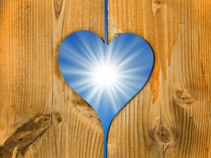 Shining sun in a wooden heart frame