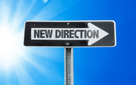 New Direction direction sign with a beautiful day