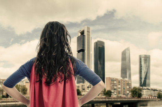 Woman Superhero In The City. Vintage Color.